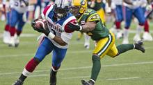 Montreal Alouettes Arland Bruce (1) is chased down by Edmonton Eskimos T.J. Hill (12) during first half action in Edmonton, Alta., on Saturday October 5, 2013. (JASON FRANSON/THE CANADIAN PRESS)