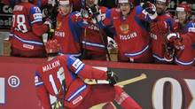 Russia's Yevgeni Malkin celebrates his third goal during the semi-final match Russia vs Finland of the 2012 IIHF World Championships in Helsinki, Finland, on Saturday May 19, 2012. (Kimmo Mantyla/AP/Kimmo Mantyla/AP)