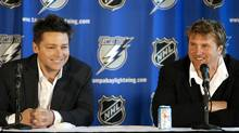 The Tampa Bay Lightning introduce Oren Koules (L) and Len Barrie as part of the new ownership group for the NHL team during a news conference in Tampa, Florida, June 23, 2008. REUTERS/Mike Carlson (UNITED STATES)