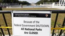A closure sign is seen on a barricade at the World War Two Memorial in Washington October 1, 2013. (Kevin Lamarque/REUTERS)