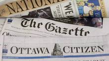 Some of Postmedia's newspapers are displayed in this 2010 file photo (Adrian Wyl/The Canadian Pres)
