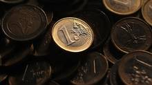 Euro coins are seen in this photo illustration taken in Rome, December 9, 2011. (TONY GENTILE/Tony Gentile/REUTERS)