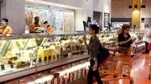People shop at the Loblaws at Maple Leaf Gardens in Toronto in this file photo. (Matthew Sherwood For The Globe and Mail)