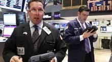 Traders work on the floor of the New York Stock Exchange, July 31, 2012. (BRENDAN MCDERMID/REUTERS)