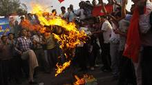 Activists of Nepali Congress affiliated Nepal Students union burn an effigy of Prime Minister Baburam Bhattarai as they demand his resignation in Katmandu, Nepal, Monday, May 28, 2012. (Binod Joshi/Associated Press/Binod Joshi/Associated Press)