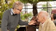 Woody Allen (left) directs Anthony Hopkins on the set of You Will Meet a Tall Dark Stranger.