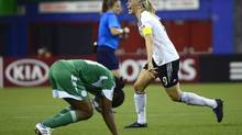 Germany's Pauline Bremer celebrates her teams victory as Nigeria's Gladys Abasi reacts in disappointment following FIFA U20 Women's World Cup final action on Sunday, August 24, 2014 in Montreal. (Paul Chiasson/THE CANADIAN PRESS)