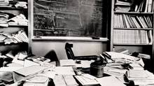 Familiar pipe, an open book, a cluttered desk and a blackboard covered with mathematical equations surround the empty chair in Dr. Albert Einstein's office at the Institute for Advanced Study in Princeton, N. J. (1965)