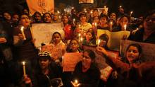 Indian students hold candles to condemn the gang-rape of a student in New Delhi last week during a protest in Allahabad, India, Sunday, Dec. 23, 2012. (Rajesh Kumar Singh/AP)