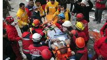 Rescue workers carry earthquake survivor Mehmet Zengin to an ambulance after he was found in a collapsed building in Van, eastern Turkey November 10, 2011. Rescue workers searched for survivors under rubble in eastern Turkey Thursday after the second earthquake in three weeks killed at least seven people, inflating the death toll of 600 from the previous tremor. (STRINGER/REUTERS/STRINGER/REUTERS)