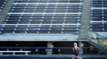Dr. Robert Gazzale, an economist at the University of Toronto, trains at Varsity Stadium on Saturday. (Darren Calabrese For the Globe and Mail)