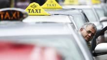 Ambassador taxi drivers wait for fares outside Union Station in Toronto, May, 2011. Startup company Uber has since come to the city, and it uses mobile technology to bypass a cab dispatch system that's still rooted in the era of operators and pay phones. (Kevin Van Paassen/The Globe and Mail)