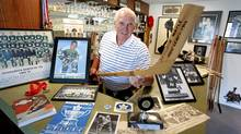 "Bob Barlow, former player for 1966 Victoria Maple Leafs, the last pro hockey team to have won a championship for the BC capital, stands at his ""hockey bar"" in his home in Victoria, Bc, Saturday. (Deddeda Stemler for The Globe and Mail/Deddeda Stemler for The Globe and Mail)"