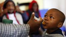 A boy receives medication at Nkosi's Haven, south of Johannesburg November 25, 2011, which provides care for destitute HIV-positive mothers and their children, whether HIV-positive or not. (SIPHIWE SIBEKO/Reuters)
