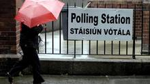 A woman leaves a polling station in North Dublin, Ireland, on Thursday, May 31. (Peter Morrison/AP)
