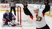 Ottawa Senators' Erik Karlsson, right, celebrates after scoring in a shootout against the New York Rangers, in New York in this March 24, 2011 file photo. (The Canadian Press)