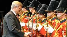 Prime Minister Stephen Harper greets band members during the opening of a performing-arts centre in Burlington, Ont., on Dec. 2, 2011. (MIKE CASSESE/Mike Cassese/Reuters)
