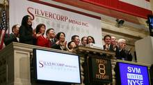 Employees and guests of Silvercorp Metals attend the opening bell at the New York Stock Exchange, March 8, 2010. (Mark Lennihan/The Associated Press)