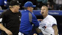 Toronto Blue Jays batter Brett Lawrie (R ) is held back by manager John Farrell during an argument with home plate umpire Bill Miller (L) after Lawrie was called out on strikes during the ninth inning of their MLB American League game against the Tampa Bay Rays in Toronto May 15, 2012. (Mike Cassese/Reuters/Mike Cassese/Reuters)