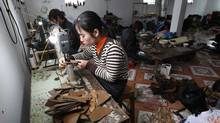 Labourers make shoes in Gie Ha, 40 km south of Hanoi. Rising inflation in Vietnam has sparked industrial unrest and more than 800 strikes in the first 11 months of 2011. (Kham/Reuters/Kham/Reuters)