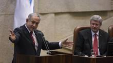 Prime Minister Stephen Harper listens as Prime Minister Benjamin Netanyahu addresses the Knesset on Jan. 20, 2014. (BAZ RATNER/REUTERS)