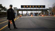 A South Korean security guard stands guard on an empty road which leads to the Kaesong Industrial Complex at the South's CIQ (Customs, Immigration and Quarantine), just south of the demilitarized zone separating the two Koreas. (KIM HONG-JI/REUTERS)