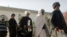 Former Taliban militants walk to hand over their weapons during a joining ceremony with the Afghan government in Herat, Afghanistan Wednesday, Dec. 28, 2011. (Hoshang Hashimi/AP/Hoshang Hashimi/AP)