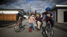 Cameron Phillips, with sons Nathan and Connor, says that men crave greater involvement with their children, but 'still feel trapped by the traditional breadwinning role.' (Rafal Gerszak For The Globe and Mail)