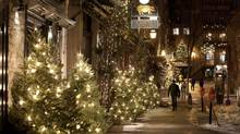 Shoppers and tourists in the Quartier Petit Champlain where Chistmas lights decorate the old part of Quebec City, on Tuesday, December 20, 2011. (Jacques Boissinot/THE CANADIAN PRESS)