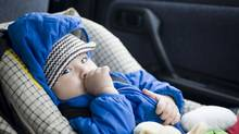 Child in a car seat. (Yo Oura/Yo Oura/iStockphoto)