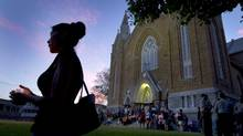 People join in an unofficial candle-light vigil on the steps of St. Agnes Church in Lac-Mégantic, Que., on July 12, 2013. (Peter Power/The Globe and Mail)