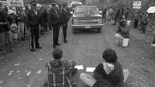Two protestors block logging trucks to Clayoquot valley near Tofino in 1993.