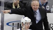 nto Maple Leafs coach Randy Carlyle gives instructions behind Carter Ashton (37) during the third period of an NHL hockey game against the Pittsburgh Penguins in Pittsburgh on Wednesday, March 7, 2012. The Penguins won 3-2. (AP Photo/Gene J. Puskar) (Gene J. Puskar/AP)