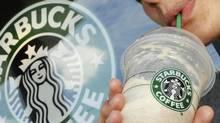 A customer sips a Starbucks beverage. (Lisa Poole/Lisa Poole/AP)