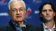 NHL Players' Association executive director Donald Fehr, center, is joined by Winnipeg Jets' Ron Hainsey as he speaks to reporters, Wednesday, Sept. 12, 2012, in New York. (Mary Altaffer/AP)