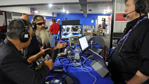 David Bossie, President of Citizens United, and Phil Robertson, of Duck Commander, talk with Stephen K. Bannon while appearing on Brietbart News Daily on SiriusXM Patriot at Quicken Loans Arena on July 21, 2016 in Cleveland, Ohio.