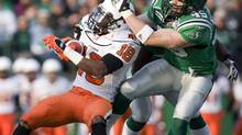 B.C. Lions slot back Cory Rodgers (left) is brought down by Saskatchewan Roughriders' Mike McCullough in first quarter CFL action on Friday, June 13, 2008 in Regina. THE CANADIAN PRESS/Troy Fleece (Troy Fleece)
