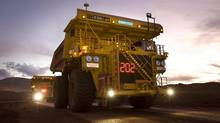 Remotely controlled tipper trucks operate at a Rio Tinto iron ore mine in Western Australia. (HANDOUT/REUTERS)