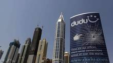 An advertisement for multilingual social network Dudu is seen on a building in Dubai Sept. 23, 2012. Middle East telcos are discussing the idea of creating a pan-Arab online platform to challenge Facebook and others. (JUMANA EL HELOUEH/REUTERS)