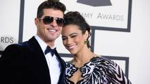 Robin Thicke, left, and Paula Patton arrive at the 56th annual Grammy Awards at Staples Center on Sunday, Jan. 26, 2014, in Los Angeles. (Jordan Strauss/AP)