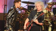 Adam Lambert, left, and Brian May of Queen perform during their concert at The Joint Hard Rock Hotel Las Vegas, Saturday, July 5, 2014. (Steve Spatafore/AP)
