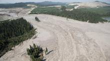 A aerial view shows the damage caused by a tailings pond breach near the town of Likely, B.C. Tuesday, August, 5, 2014. The B.C. government says water testing results following a massive mine tailings spill are within guidelines for drinking water and aquatic life. (JONATHAN HAYWARD/THE CANADIAN PRESS)
