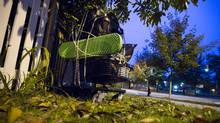 The grocery cart dumped on the lawn outside Stephen Quinn's home in Vancouver. (John Lehmann/The Globe and Mail)