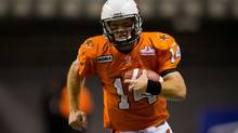 B.C. Lions' quarterback Travis Lulay runs for a first down against the Calgary Stampeders during the first half of a CFL football game in Vancouver, B.C., on Saturday October 6, 2012. (Darryl Dyck/THE CANADIAN PRESS)