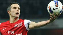 Arsenal's Robin van Persie catches the ball during their English Premier League soccer match against Newcastle United at Emirates Stadium in London March 12, 2012. REUTERS/Toby Melville (Toby Melville/Reuters)