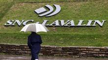 A pedestrian walks past the SNC-Lavalin Group Inc., headquarters in Montreal, May 7, 2009. SNC-Lavalin Group Inc reported a nearly 10 percent increase in first-quarter profit on Thursday, as the big Canadian engineering and construction company recorded larger gains from infrastructure concession investments such as toll roads. REUTERS/Christinne Muschi (CANADA BUSINESS) (© Christinne Muschi / Reuters/REUTERS)
