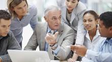 Senior business manager discussing work with his younger colleagues. (Jacob Wackerhausen/Thinkstock)