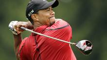 Tiger Woods watches his his tee shot on the fourth hole during the final round of the Bridgestone Invitational golf tournament on Aug. 3 at Firestone Country Club in Akron, Ohio. (Mark Duncan/AP)
