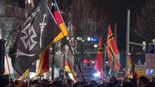 Right-wing activists protest in Leipzig on Monday against Germany's open-door refugee policy. (Jens Schlueter/Getty Images)
