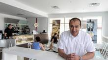 Luis Meza who owns three cafés in his home country of Venezuela is trying to make a go of it here in Canada in his Ancaster restaurant, Mezza Caffe. His wife Ronit makes food coming out of the kitchen including pizzas, sandwiches and bake goods, while son Joshua works up front as a barista. (Glenn Lowson For The Globe and Mail)